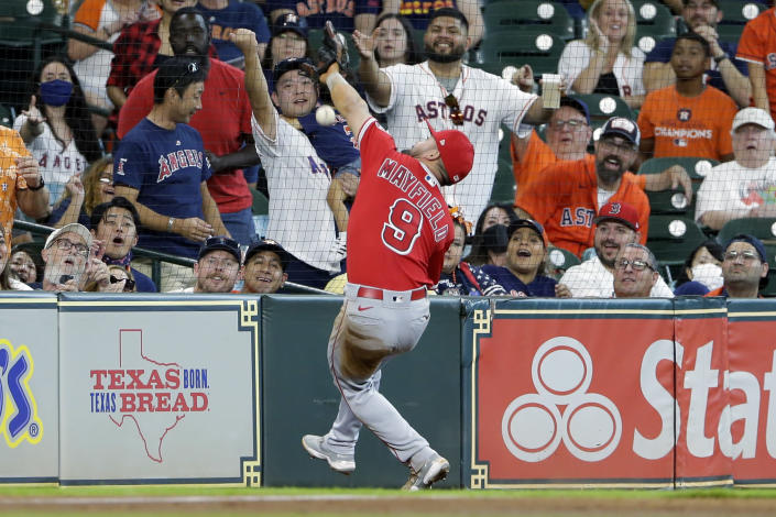 Los Angeles Angels third baseman Jack Mayfield (9) misses a catch at the net on the foul ball hit by Houston Astros' Kyle Tucker during the third inning of a baseball game Sunday, Sept. 12, 2021, in Houston. (AP Photo/Michael Wyke)