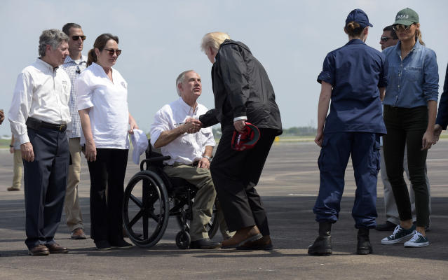 <p>President Donald Trump shakes hands with Texas Gov. Greg Abbott as he and first lady Melania Trump, right, arrive via Air Force One at Ellington Field in Houston, Saturday, Sept. 2, 2017. (Photo: Susan Walsh/AP) </p>