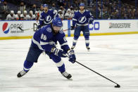 Tampa Bay Lightning right wing Nikita Kucherov (86) moves the puck against the New York Islanders during the second period in Game 7 of an NHL hockey Stanley Cup semifinal playoff series Friday, June 25, 2021, in Tampa, Fla. (AP Photo/Chris O'Meara)