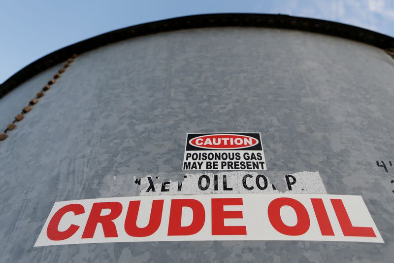 FILE PHOTO: A sticker reads crude oil on the side of a storage tank in the Permian Basin