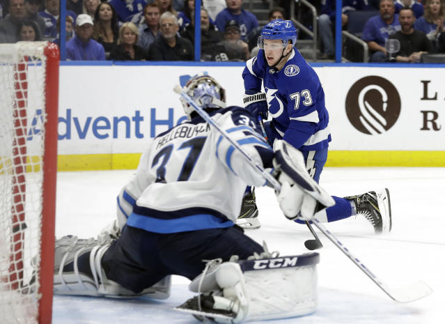 Tampa Bay Lightning left wing Adam Erne (73) watches his shot get past Winnipeg Jets goaltender Connor Hellebuyck for a goal during the second period of an NHL hockey game Tuesday, March 5, 2019, in Tampa, Fla. (AP Photo/Chris O'Meara)