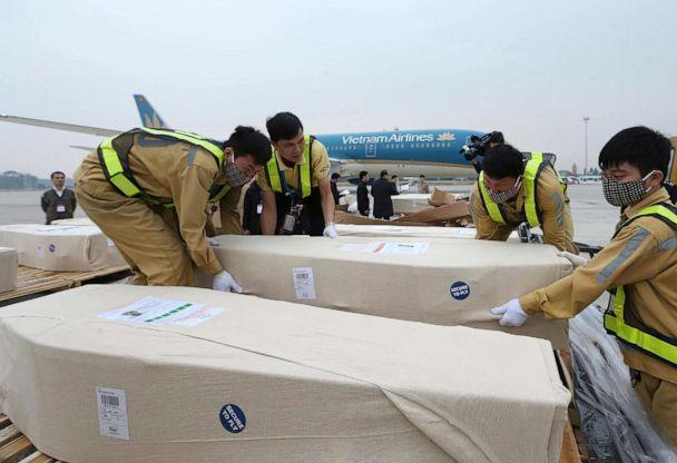 PHOTO: Coffins arrive on the tarmac of the Noi Bai airport on Nov. 27, 2019, in Hanoi, Vietnam. Media in Vietnam say the bodies of 16 of the 39 Vietnamese who died when human traffickers carried them by truck to England been repatriated to their homeland. (Vietnam News Agency via AP)
