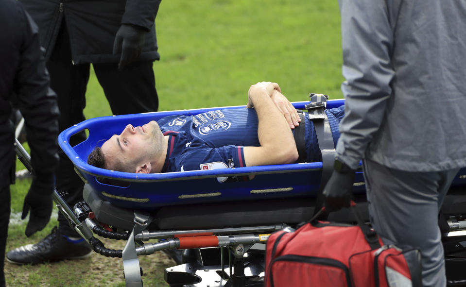 Swansea City's Jordan Morris is stretchered off the field after getting hurt during a Sky Bet Championship soccer match against Huddersfield, Saturday, Feb. 20, 2021, at John Smith's Stadium in Huddersfield, England. (Mike Egerton/PA via AP)