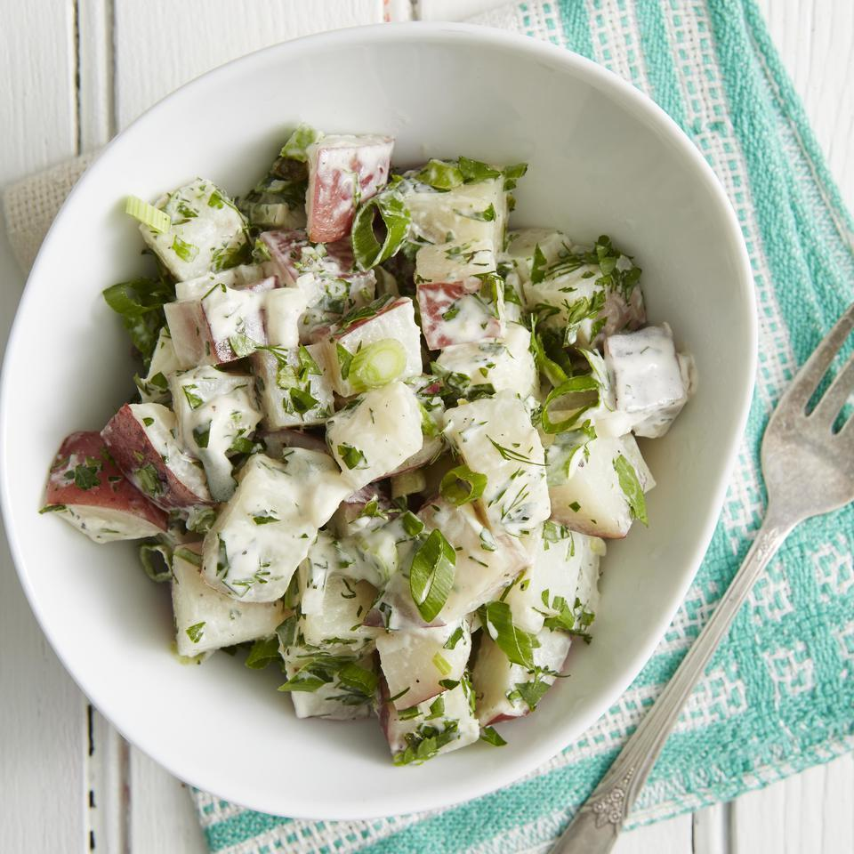 <p>In this healthy and creamy potato salad recipe, yogurt replaces half of the mayo and we keep the potato skins on for more fiber and potassium. The herbs give this potato salad a fresh and bright flavor. Feel free to experiment with your favorites.</p>