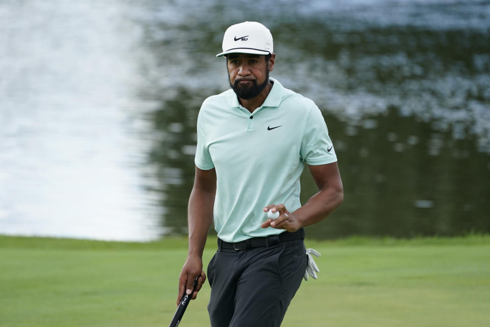 Tony Finau reacts after making a putt on the 13th hole in the final round at The Northern Trust golf tournament at Liberty National Golf Course Monday, Aug. 23, 2021, in Jersey City, N.J. (AP Photo/John Minchillo)