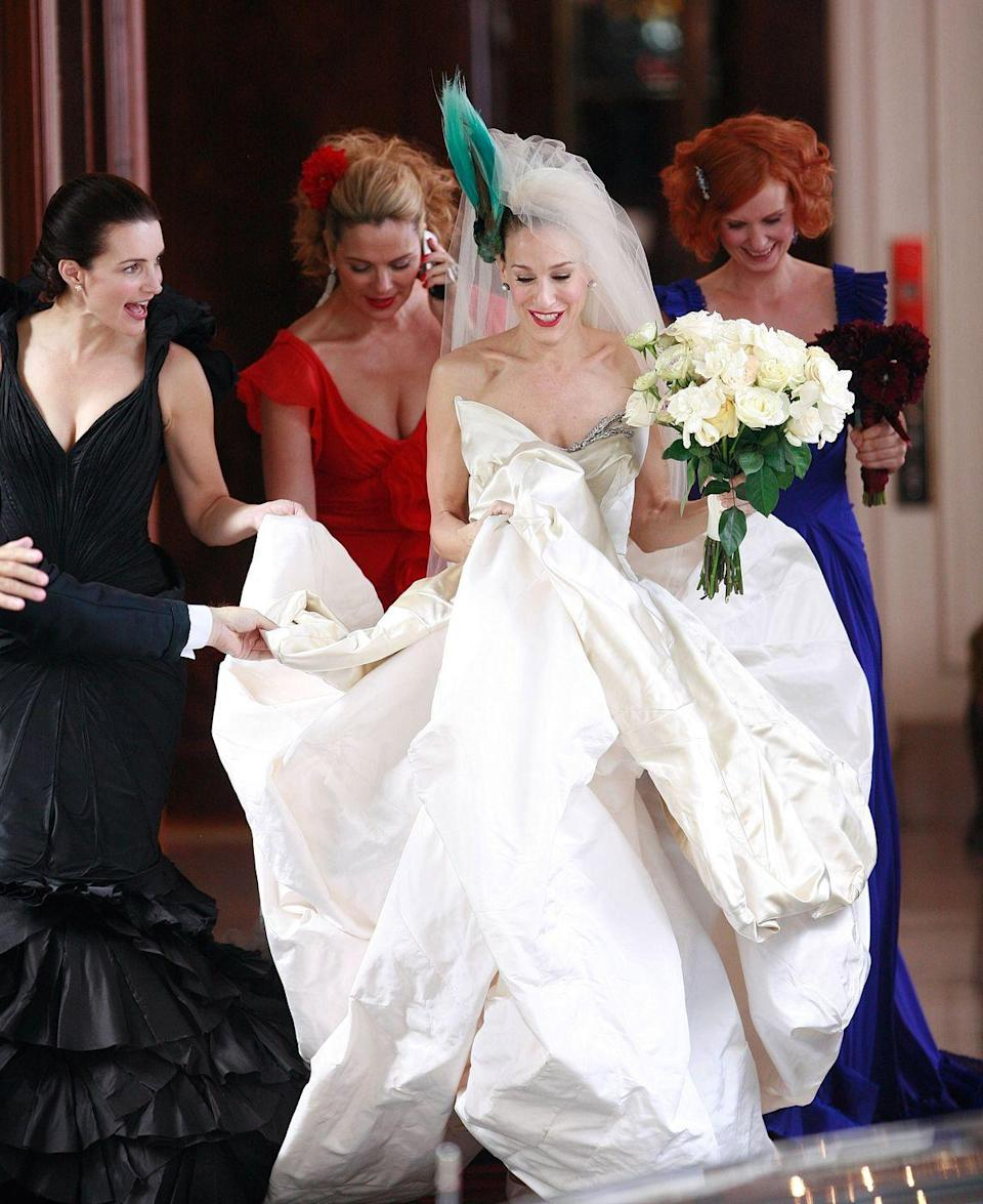 <p>Carrie Bradshaw always knew how to pioneer a trend. After her bridal entourage stepped out in three different haute couture gowns of three different colors, brides everywhere started to loosen the reins and the mix and match trend was born.</p>