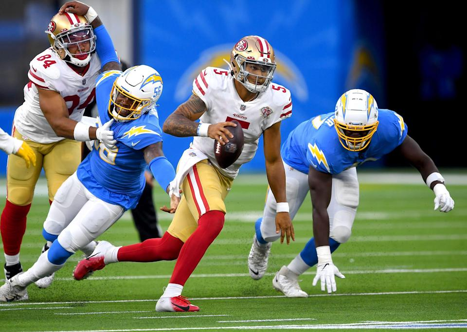 San Francisco 49ers quarterback Trey Lance (5) scrambles in the pocket during the game against the Los Angeles Chargers at SoFi Stadium.