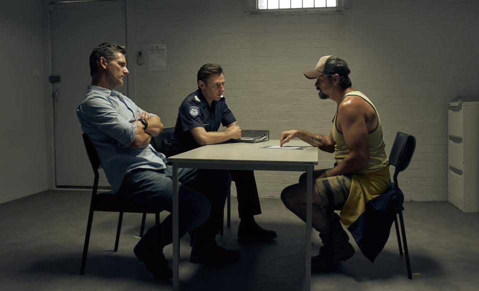 """This image released by IFC Films shows Eric Bana, from left, Keir O'Donnell and Matt Nable in a scene from """"The Dry."""" (Ben King/IFC Films via AP)"""