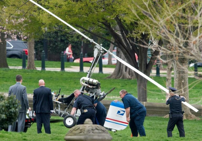 """The gyrocopter a Florida mailman angry about """"corruption"""" in washington landed near the US Capitol in protest in April 2015 Capitol Hill police officers and other officials lift a gyrocopter that landed on the US Capitol South Lawn, on to a trailer, April 15, 2015, in Washington, DC. A man identified as Doug Hughes, 61, flying a gyrocopter, illegally landed his aircraft on the west lawn of the US Capitol Wednesday, triggering street closures around the building and prompting a police investigation. Hughes is described as a mailman, and a logo appearing to be that of the US Postal Service was visible on the tail fin of the aircraft. AFP PHOTO/PAUL J. RICHARDSCapitol Hill police officers and other officials lift a gyrocopter that landed on the US Capitol South Lawn, on to a trailer, April 15, 2015, in Washington, DC. A man identified as Doug Hughes, 61, flying a gyrocopter, illegally landed his aircraft on the west lawn of the US Capitol Wednesday, triggering street closures around the building and prompting a police investigation. Hughes is described as a mailman, and a logo appearing to be that of the US Postal Service was visible on the tail fin of the aircraft. AFP PHOTO/PAUL J. RICHARDS (AFP Photo/PAUL J. RICHARDS)"""