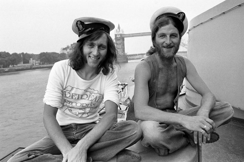 Chas right, and Dave Peacock pictured together on HMS Belfast in 1975 (PA)