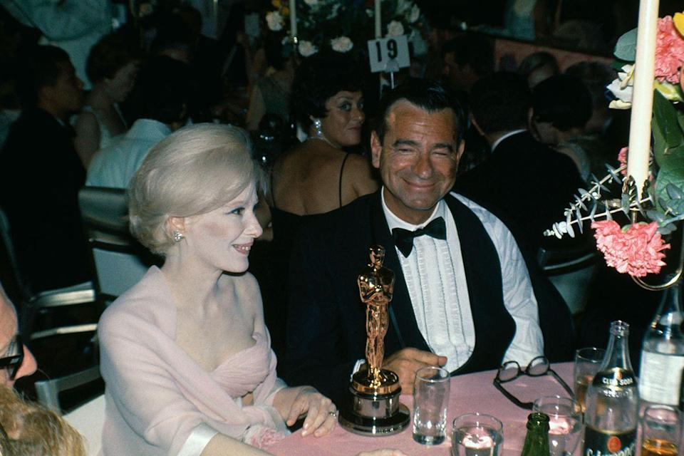 "<p>Walter Matthau was all smiles back at his table after winning Best Supporting Actor for <em><a href=""https://www.amazon.com/Fortune-Cookie-Jack-Lemmon/dp/B01MTY4JPJ/ref=sr_1_1?s=instant-video&ie=UTF8&qid=1547579222&sr=1-1&keywords=The+Fortune+Cookie&tag=syn-yahoo-20&ascsubtag=%5Bartid%7C10055.g.5132%5Bsrc%7Cyahoo-us"" rel=""nofollow noopener"" target=""_blank"" data-ylk=""slk:The Fortune Cookie"" class=""link rapid-noclick-resp"">The Fortune Cookie</a></em>. A strike by the American Federation of Television and Radio Artists<span class=""redactor-invisible-space""> nearly kept the whole show from happening, but a settlement was reached hours before the ceremony.</span></p>"
