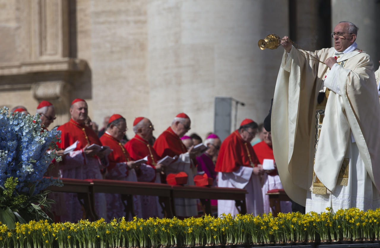 Pope Francis incenses the faithful as he arrives to celebrate an Easter Sunday Mass in St. Peter's Square at the Vatican Sunday, April 20, 2014. (AP Photo/Andrew Medichini)