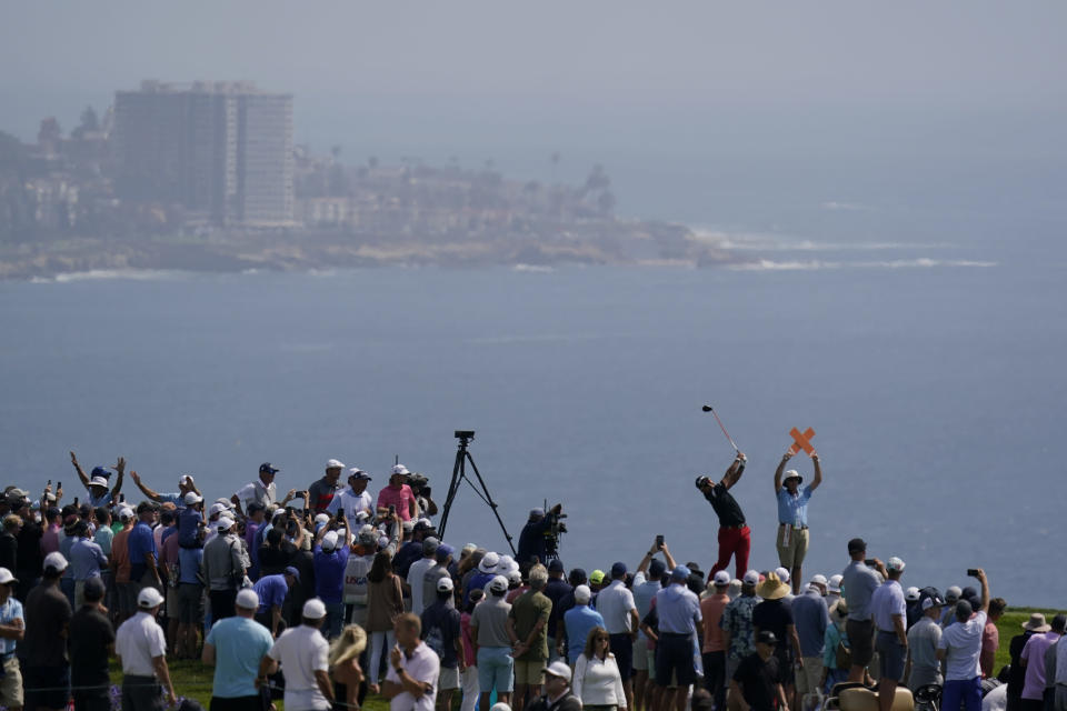 Fans watch as Hideki Matsuyama, of Japan, plays his shot from the fourth tee during the first round of the U.S. Open Golf Championship, Thursday, June 17, 2021, at Torrey Pines Golf Course in San Diego. (AP Photo/Gregory Bull)