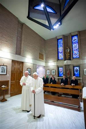 Pope Francis (L) prays with Pope Emeritus Benedict XVI at the Mater Ecclesiae monastery at the Vatican, December 23, 2013. REUTERS/Osservatore Romano