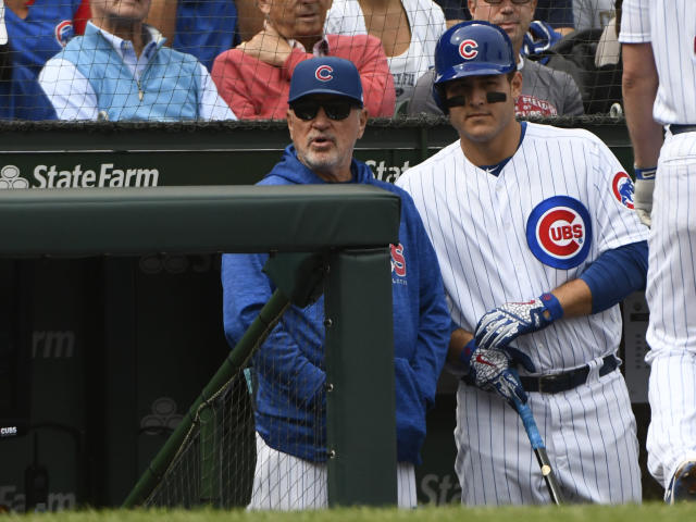 Chicago Cubs manager Joe Maddon, left, has an interesting offseason reading choice. (AP)
