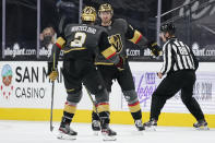 Vegas Golden Knights defenseman Zach Whitecloud (2) celebrates after center Nicolas Roy, right, scored against the St. Louis Blues during the third period of an NHL hockey game Friday, May 7, 2021, in Las Vegas. (AP Photo/John Locher)