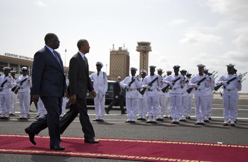 U.S. President Barack Obama, right, walks to Air Force One during a departure ceremony with Senegalese President Macky Sall on Friday, June 28, 2013, in Dakar, Senegal. Obama is visiting Senegal, South Africa, and Tanzania on a week long trip. (AP Photo/Evan Vucci)