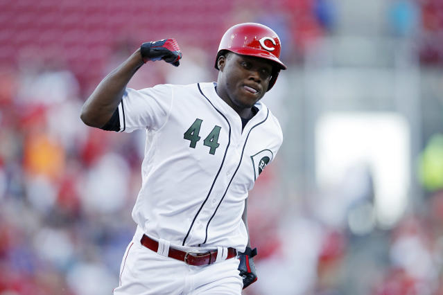 Reds rookie Aristides Aquino is making fans forget about Yasiel Puig after tying the home run record for first 10 games. (Joe Robbins/Getty Images)