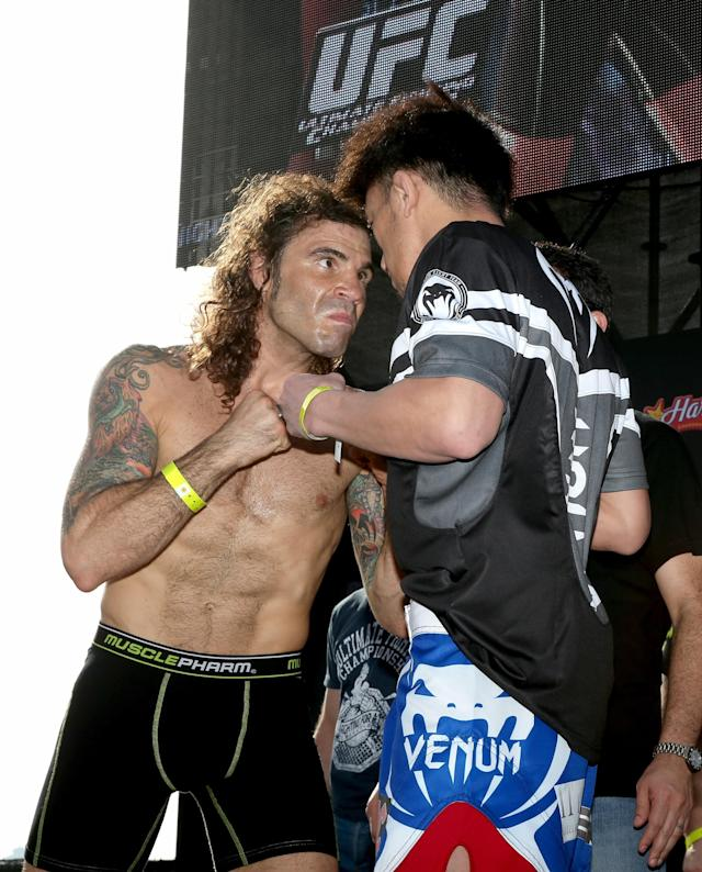 ABU DHABI, UNITED ARAB EMIRATES - APRIL 10: Clay Guida and Tatsuya Kawajiri of Japan face-off after they weigh-in for UFC Fight Night 39 on April 10, 2014 in Abu Dhabi, United Arab Emirates. UFC Fight Night 39 will take place on April 11 at du Arena featuring Antonio Rodrigo Nogueira and Roy Nelson. (Photo by Maxx Wolfson/Getty Images)