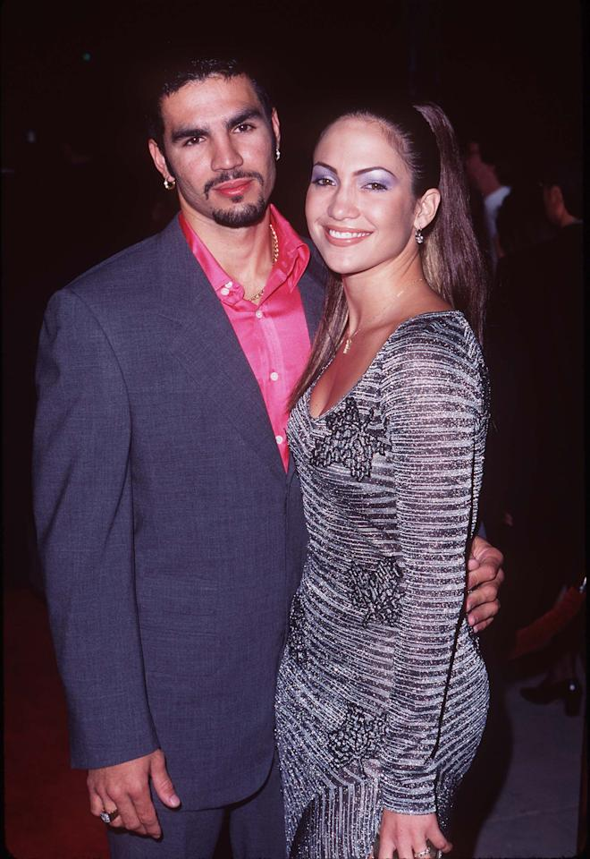 <p>Long before JLo's first husband Ojani Noa threatened to release a sex tape of her last year, the pair met in a Cuban restaurant where he was a waiter, making for a year-long marriage that saw JLo in body con dresses and blue eye shadow while he opted for hot pink button-ups.</p>