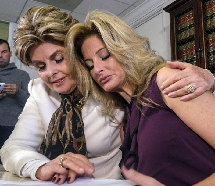Attorney Gloria Allred, left, comforts Summer Zervos who accuses Donald Trump of victimizing her with inappropriate sexual conduct, during a news conference in Los Angeles on Friday Oct. 14, 2016. Summer Zervoshe latest woman to publicly accuse Trump of inappropriate behavior accusation. (Photo: Ringo H.W. Chiu/AP)