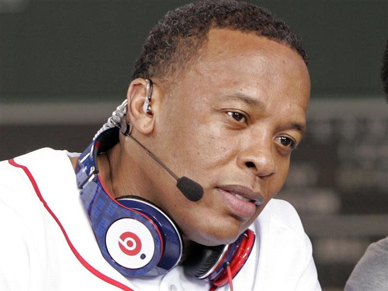Recording artist Dr. Dre wears a pair of Beats headphones as he attends the 2010 season opener baseball game between the New York Yankees and Boston Red Sox in Boston
