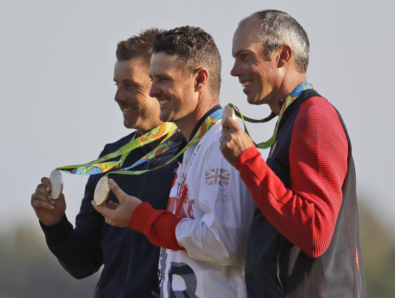 FILE - In this Aug. 14, 2016, file photo, from left are silver medalist Henrik Stenson, of Sweden; gold medalist Justin Rose, of Britain; and bronze medalist Matt Kuchar, of the United States, after the final round of the men's golf event at the Summer Olympics in Rio de Janeiro, Brazil. Unlike other Olympic sports, the postponement to 2021 was little more than an inconvenience in golf. (AP Photo/Chris Carlson, File)
