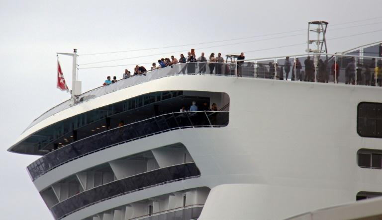 Passengers remain onboard the MSC Meraviglia cruise ship in Cozumel, Mexico, awaiting a decision on whether they can disembark (AFP Photo/JOSE CASTILLO)