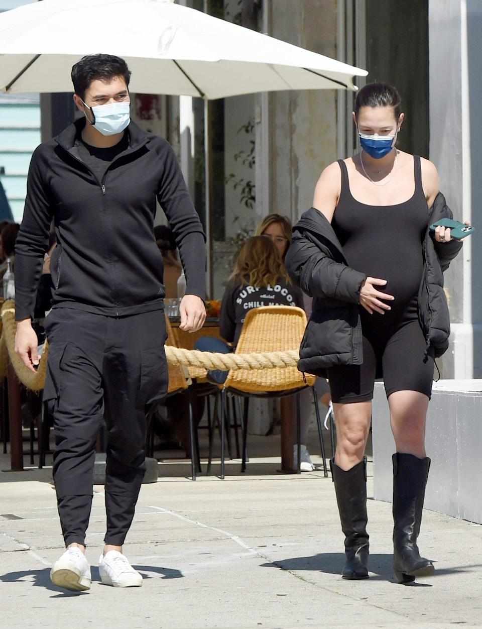 <p>Henry Golding and pregnant wife Liv Lo keep it coordinated while out in Los Angeles on Friday.</p>