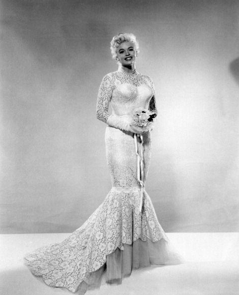 <p>The '50s bombshell chose a wedding dress with a fitted mermaid style, to compliment her hourglass figure, when she married body builder, Mickey Hargitay. </p>