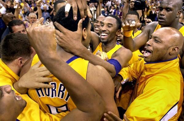 Robert Horry is mobbed by Kobe Bryant and other Lakers after making the winning shot against Sacramento in the 2002 playoffs.