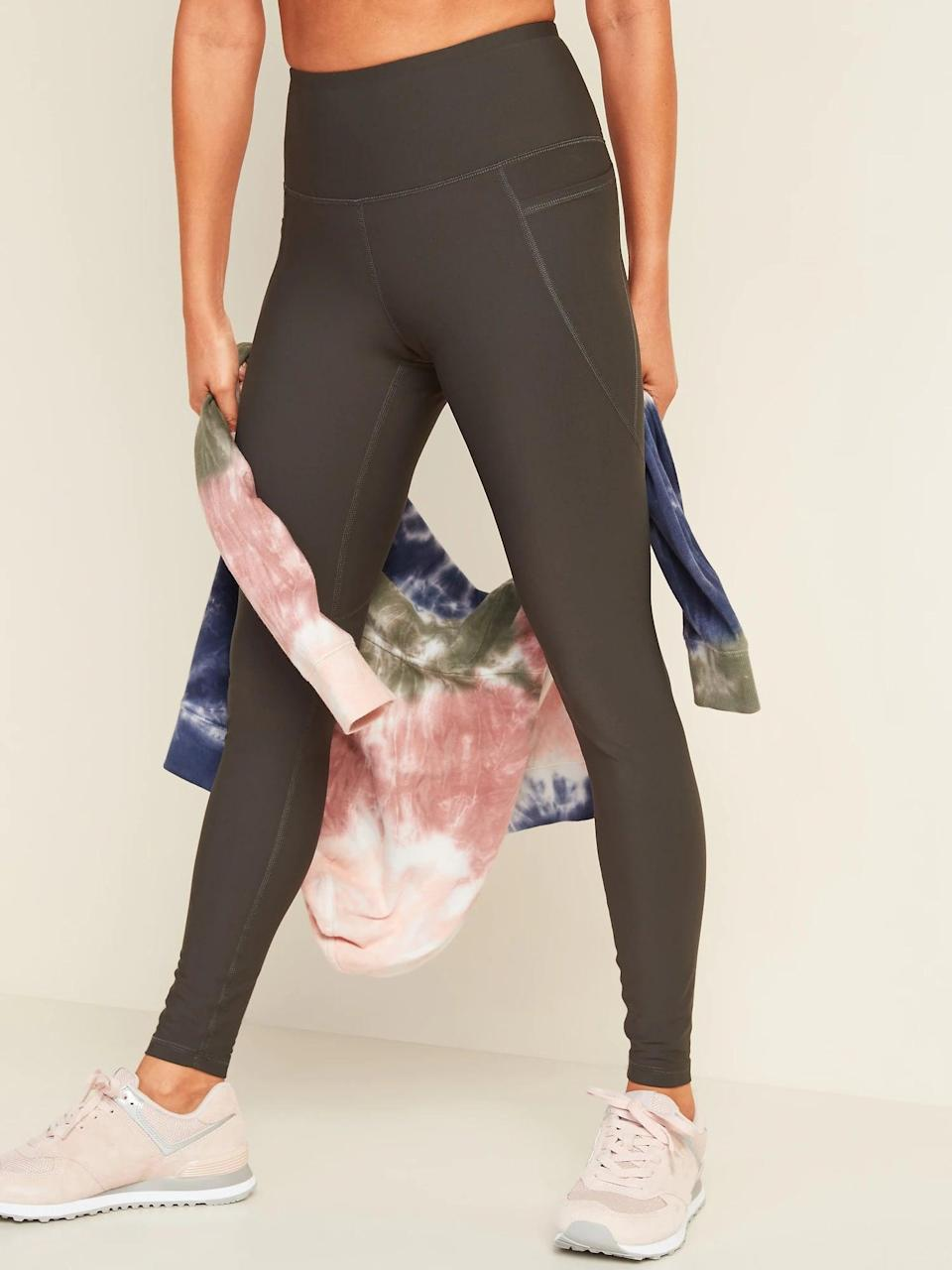 """<p>""""The best feature of the <span>High-Waisted Powersoft Side-Pocket Leggings</span> ($30, originally $40) is the waistband. It's nice and high, which makes me feel super secure when doing any sort of HIIT workout where jumping is involved, and it's thick, which means no nasty fabric marks on my skin."""" - RB</p> <p>Read the full <a href=""""https://www.popsugar.com/fitness/old-navy-high-waisted-workout-leggings-review-47958729"""" class=""""link rapid-noclick-resp"""" rel=""""nofollow noopener"""" target=""""_blank"""" data-ylk=""""slk:Old Navy High-Waisted Powersoft Side-Pocket Leggings review"""">Old Navy High-Waisted Powersoft Side-Pocket Leggings review</a>.</p>"""