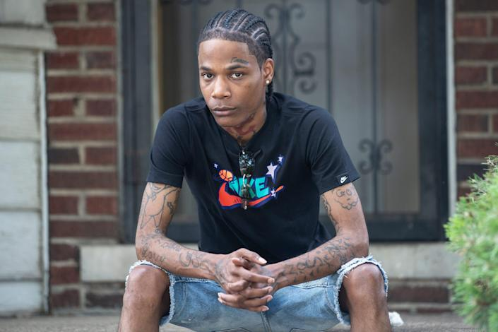 Michael Oliver, 26, poses for a photo in his neighborhood in Detroit on July 8, 2020. Last year, he was accused of reaching into a vehicle, grabbing a cell phone from a man then damaging it. Officials concluded Oliver had been misidentified as the perpetrator and dismissed the case. Detroit police used facial recognition technology in the investigation.