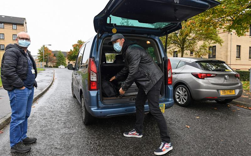 A foreign student attending Glasgow University leaves the Murano Street student village on September 28 - Getty Images Europe