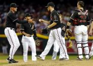 Arizona Diamondbacks manager Kirk Gibson, left, pulls Ian Kennedy from the game during the sixth inning of a baseball game against the Los Angeles Dodgers as catcher Miguel Montero (26) looks on, Saturday, April 13, 2013, in Phoenix. (AP Photo/Matt York)