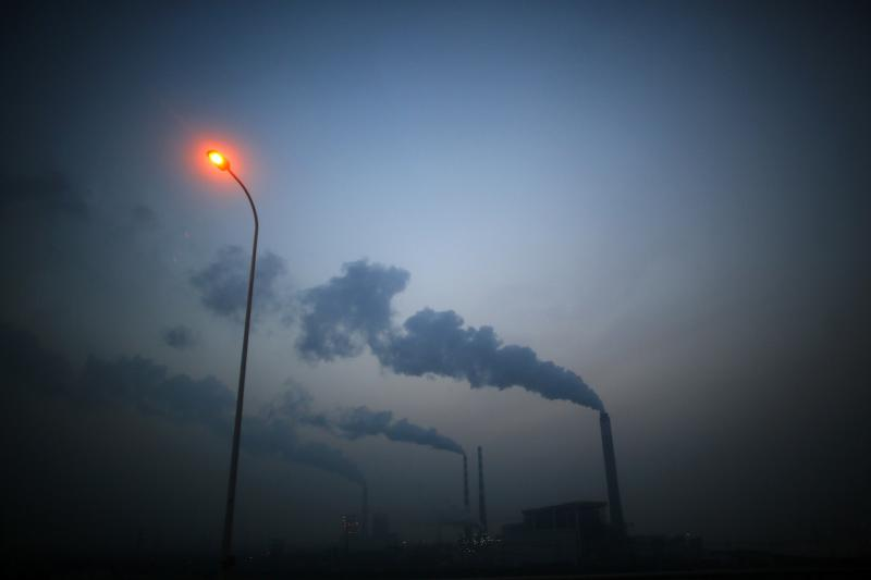 """Smoke rises from chimneys of a thermal power plant near Shanghai March 26, 2014. China's energy-hungry, high-polluting industries continued to grow too fast in 2013, putting """"huge pressures"""" on the environment and causing air quality to worsen, the country's pollution agency said on Tuesday. Premier Li Keqiang """"declared war"""" on pollution in a major policy address this month, but China has long struggled to strike a balance between protecting the environment and keeping up economic growth. REUTERS/Carlos Barria (CHINA - Tags: BUSINESS ENVIRONMENT SOCIETY POLITICS)"""