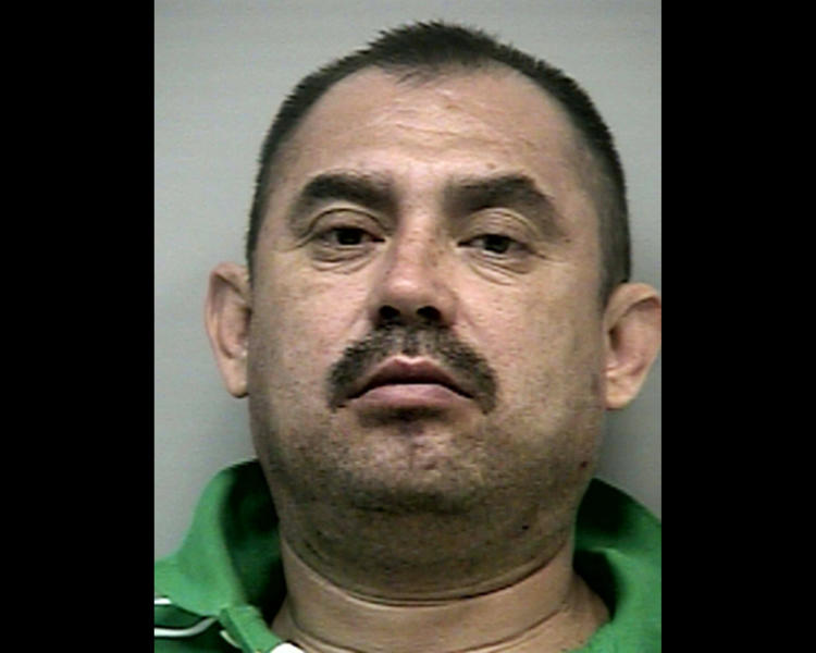 This 2009 photo provided by the Gwinnett County Sheriff's Department in Lawrenceville, Ga., shows reputed cartel operative Socorro Hernandez-Rodriguez after his arrest in a suburb of Atlanta. Hernandez-Rodriguez was later convicted of sweeping drug trafficking charges. Prosecutors said he was a high-ranking figure in the La Familia cartel, sent to the U.S. to run a drug cell. His defense lawyers denied he was a major figure in the cartel. (AP Photo/Courtesy of the Gwinnett County Sheriff's Department)