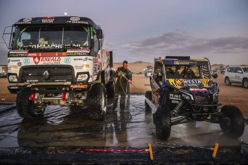 In this Thursday, Jan. 9, 2020 photo, a competitor washes a Can-Am SSV after stage five of the Dakar Rally in Hail, Saudi Arabia. Formerly known as the Paris-Dakar Rally, the race was created by Thierry Sabine after he got lost in the Libyan desert in 1977. Until 2008, the rallies raced across Africa, but threats in Mauritania led organizers to cancel that year's event and move it to South America. It has now shifted to Saudi Arabia. The race started on Jan. 5 with 560 drivers and co-drivers, some on motorbikes, others in cars or in trucks. Only 41 are taking part in the Original category. (AP Photo/Bernat Armangue)