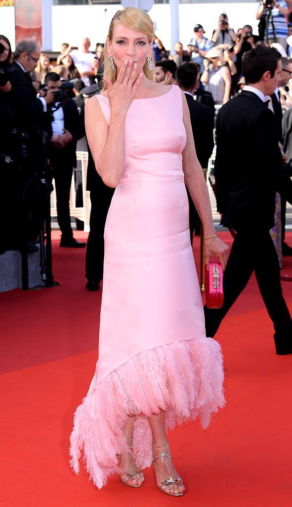 <p>The actress blew a kiss — and blew us away – on May 23 at the Anniversary Soiree, which marked the 70th year of the film festival. Her pink dress made her look candy-sweet, and the feathers on the bottom added a fun kick. (Photo: David Fisher/REX/Shutterstock) </p>