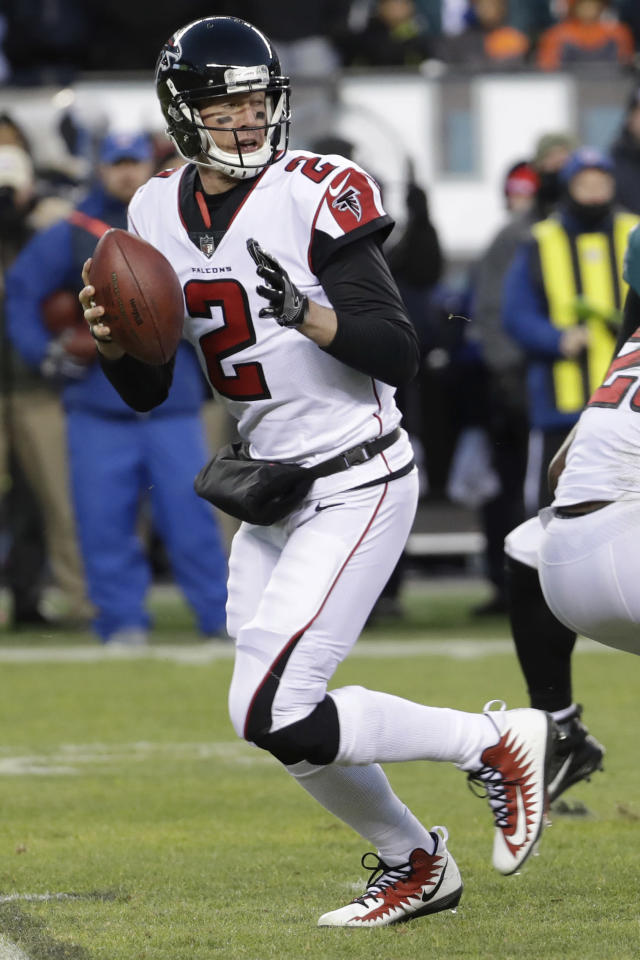 File- This Jan. 13, 2018, file photo shows Atlanta Falcons' Matt Ryan in action during the first half of an NFL divisional playoff football game against the Philadelphia Eagles in Philadelphia. The Falcons have entered the free-agency period facing financial constraints in the leagues soaring market for quarterbacks. An offseason priority is reaching a new deal with Ryan, the 2016 NFL MVP who can become a free agent following his 2018 final season on his six-year, $103.75 million contract. (AP Photo/Chris Szagola, File)