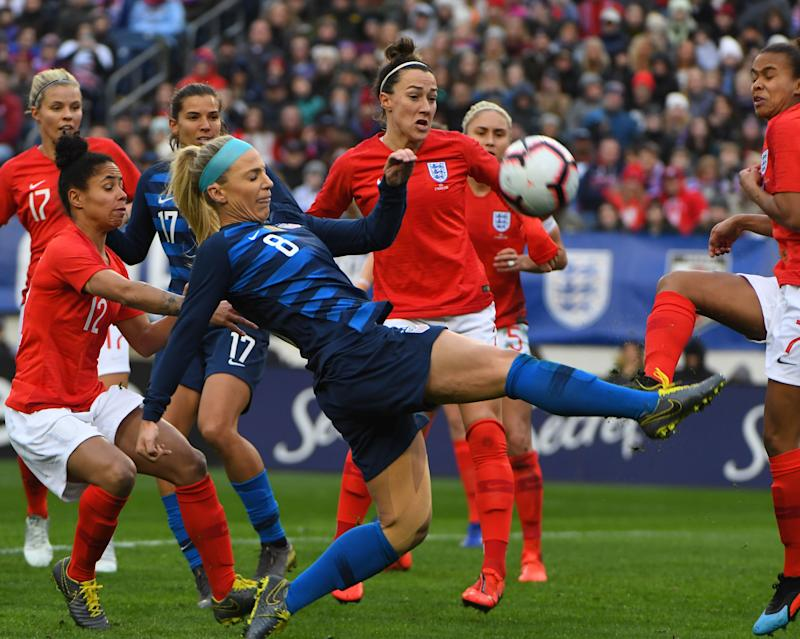 Mar 2, 2019; Nashville, TN, USA; United States midfielder Julie Ertz (8) plays the ball on a corner kick in the first half against England during a She Believes Cup women's soccer match at Nissan Stadium. Mandatory Credit: Christopher Hanewinckel-USA TODAY Sports