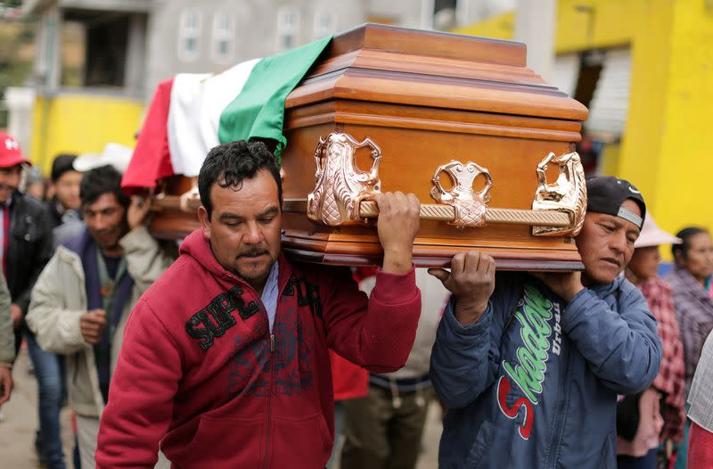 Relatives and friends carry the coffin of environmental activist Homero Gomez, during his funeral service in the western Mexican state of Michoacan