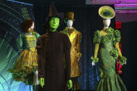"""Costumes from the Broadway musical """"Wicked"""" are displayed at the """"Showstoppers! Spectacular Costumes from Stage & Screen"""" exhibit, benefitting the Costume Industry Coalition Recovery Fund, in Times Square on Monday, Aug. 2, 2021, in New York. (Photo by Andy Kropa/Invision/AP)"""