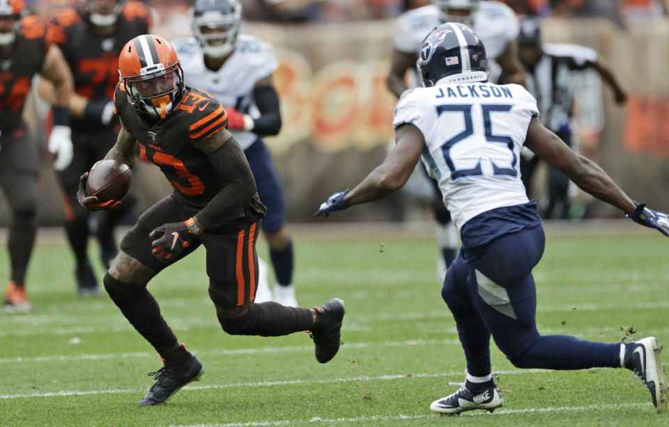 Cleveland Browns wide receiver Odell Beckham Jr. (13) avoids Tennessee Titans cornerback Adoree' Jackson (25) during the first half in an NFL football game Sunday, Sept. 8, 2019, in Cleveland. (AP Photo/Ron Schwane)