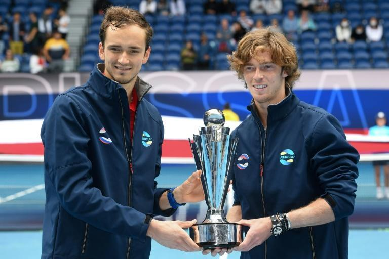 Russia's Daniil Medvedev (left) and Andrey Rublev lift the ATP Cup after beating Italy in the final