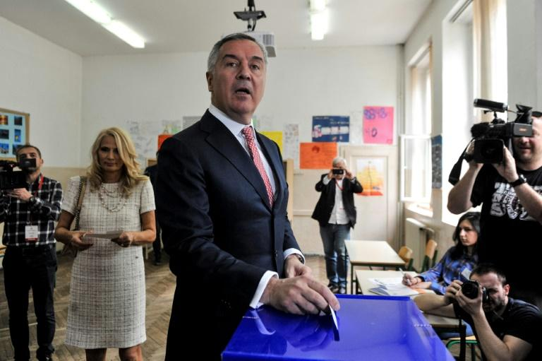 Six-time former prime minister Milo Djukanovic votes in Montenegro's presidential election on Sunday, which is widely expected to win