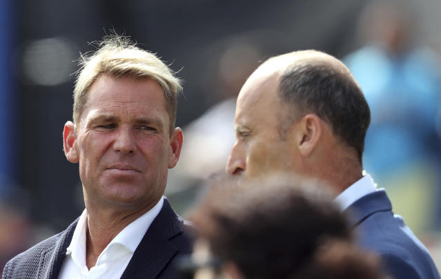 Australian cricket player Shane Warne, left, with former England cricket captain Nasser Hussein during the Cricket World Cup semi-final match between Australia and England at Edgbaston in Birmingham, England, Thursday, July 11, 2019. (AP Photo/Rui Vieira)