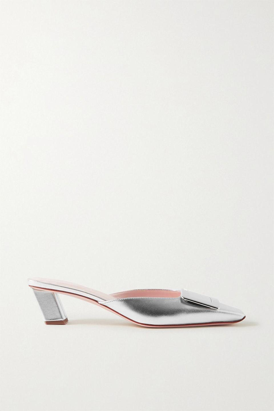 """<p><strong>Roger Vivier</strong></p><p>net-a-porter.com</p><p><strong>$750.00</strong></p><p><a href=""""https://go.redirectingat.com?id=74968X1596630&url=https%3A%2F%2Fwww.net-a-porter.com%2Fen-us%2Fshop%2Fproduct%2Froger-vivier%2Fshoes%2Fmid-heel%2Fbelle-vivier-metallic-leather-mules%2F24092600056996354&sref=https%3A%2F%2Fwww.townandcountrymag.com%2Fstyle%2Ffashion-trends%2Fg36544376%2Fbest-metallic-accessories%2F"""" rel=""""nofollow noopener"""" target=""""_blank"""" data-ylk=""""slk:Shop Now"""" class=""""link rapid-noclick-resp"""">Shop Now</a></p><p>Roger Vivier pumps are a French classic (Catherine Deneuve wore a pair in the 1967 film <em>Belle de Jour</em>). These mules feature the same square toe and buckle, but with a sleeker look and silvery finish. </p>"""