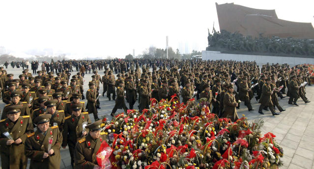 North Koreans offer flowers at Mansudae in Pyongyang on the eve of the second anniversary of the death of former leader Kim Jong Il