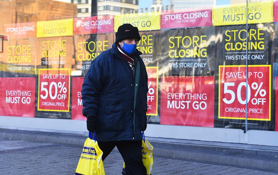 BIRMINGHAM, ENGLAND - JANUARY 05: : A man wearing a mask walks past a closing down sign in Birmingham during the nationwide lockdown on January 05, 2021 in Birmingham, England. British Prime Minister made a national television address on Monday evening  announcing England is to enter its third coronavirus lockdown of the year. On Monday the UK recorded more than 50,000 new confirmed Covid cases for the seventh day in a row. (Photo by Nathan Stirk/Getty Images)